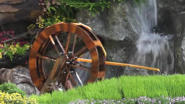 Water wheel turbine. The use falling water to irrigation .Thailand