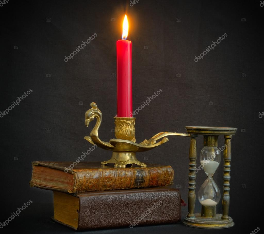 Magic books hourglass and candle — Stock Photo