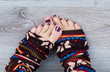 Female feet in colorful socks