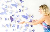 Fotografie 蝶が付いている壁