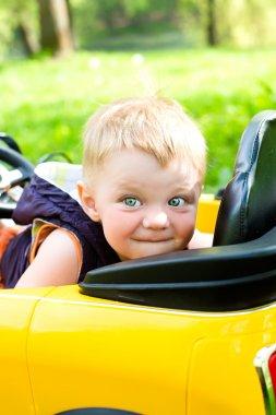 Boy won his yellow car