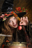 Halloween witch with poisoned apple