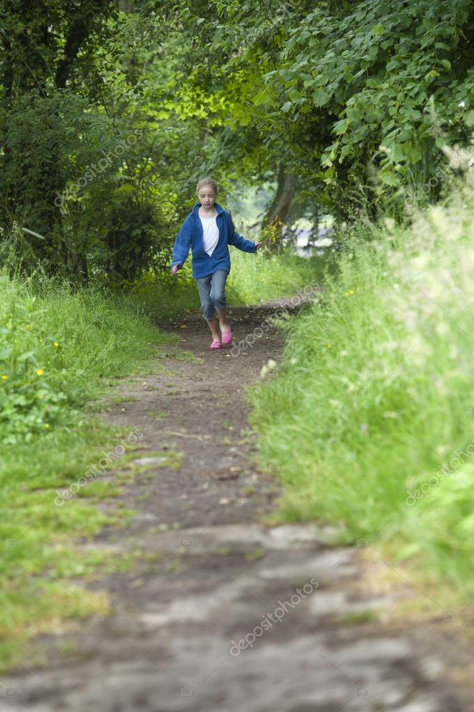 summer holidays, girl running in the woods