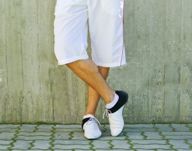 Man's legs in sportswear