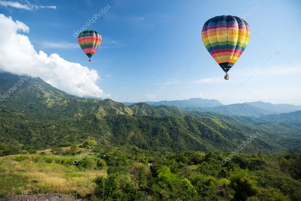 Hot air balloon over mountain landscape
