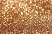 Mihotavý zlatého světla a hvězdy Vánoční pozadí