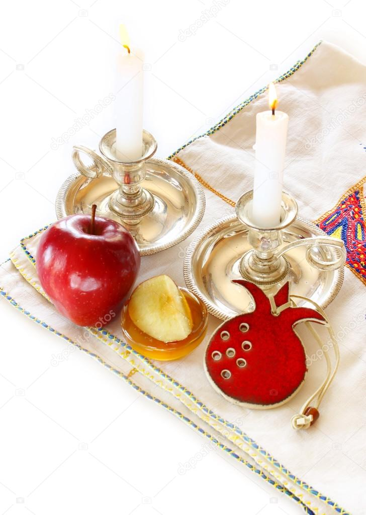 Jewish New Year - Rosh Hashanah , apple with honey and candles isolated