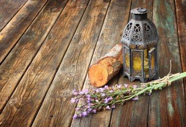 Vintage oriental lamp, sage plant