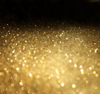 Golden background of defocused abstract lights.