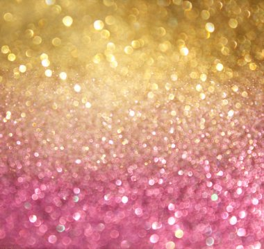 Golden and pink abstract bokeh lights. defocused background