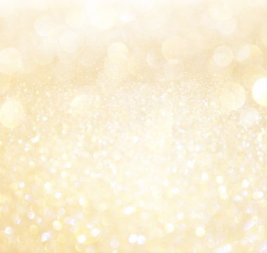 White and gold abstract bokeh lights. defocused background
