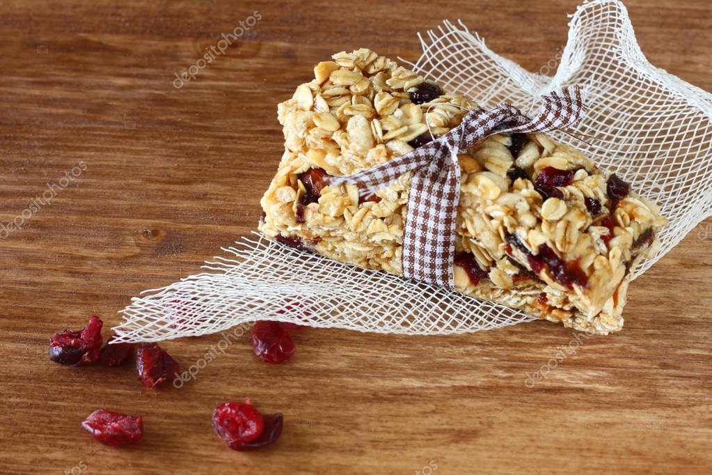 Granola bar or energy bar on wooden background