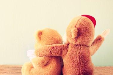 Two teddy bears on a shelf