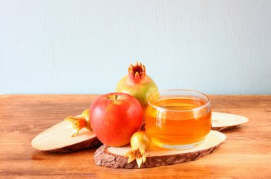 Apple honey and pomegranate over wooden table.
