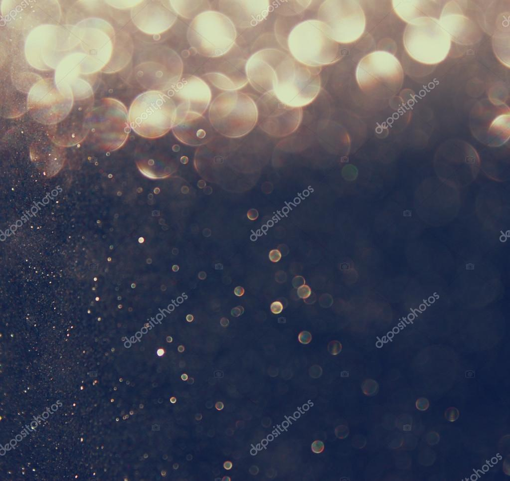 Silver and golden background of defocused abstract lights. bokeh lights.