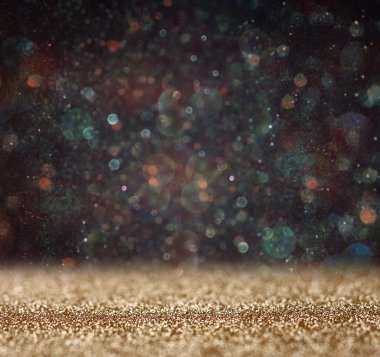 Glitter vintage lights background. light gold and black. defocused