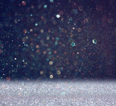 Glitter vintage lights background. light blue and black. defocused
