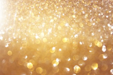 Abstract photo of light burst and glitter bokeh lights. image is blurred and filtered .