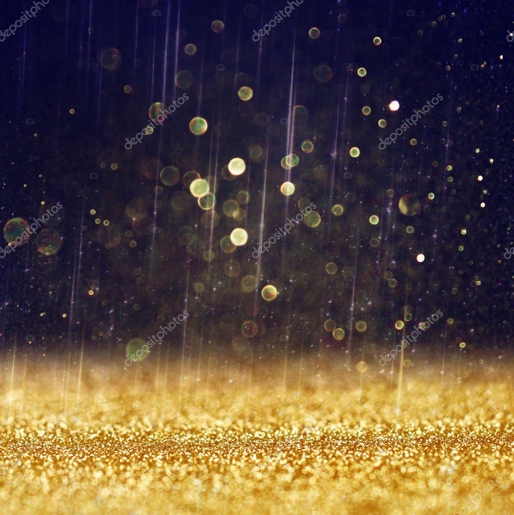 Glitter vintage lights background. light gold and black. defocused.