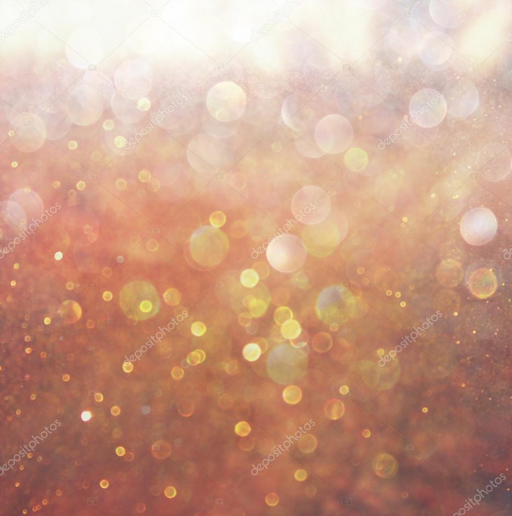 Abstract photo of light burst among trees and glitter bokeh lights. filtered image and textured. image is blurred.