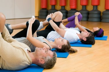 Stretching exercises at gym