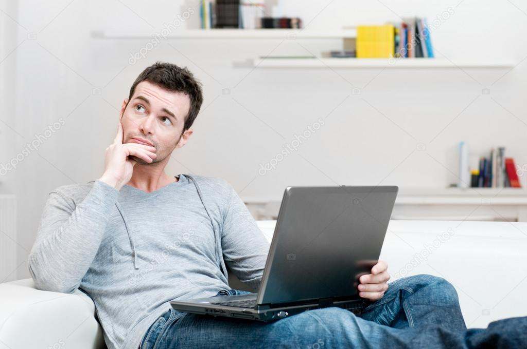 Absorbed and confused man on laptop