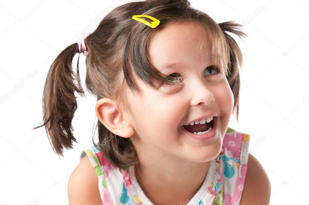 Happy smiling little girl having fun isolated on white background
