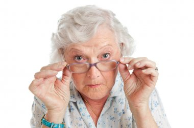 Happy surprised old senior lady looking through her eyeglasses isolated on white background stock vector