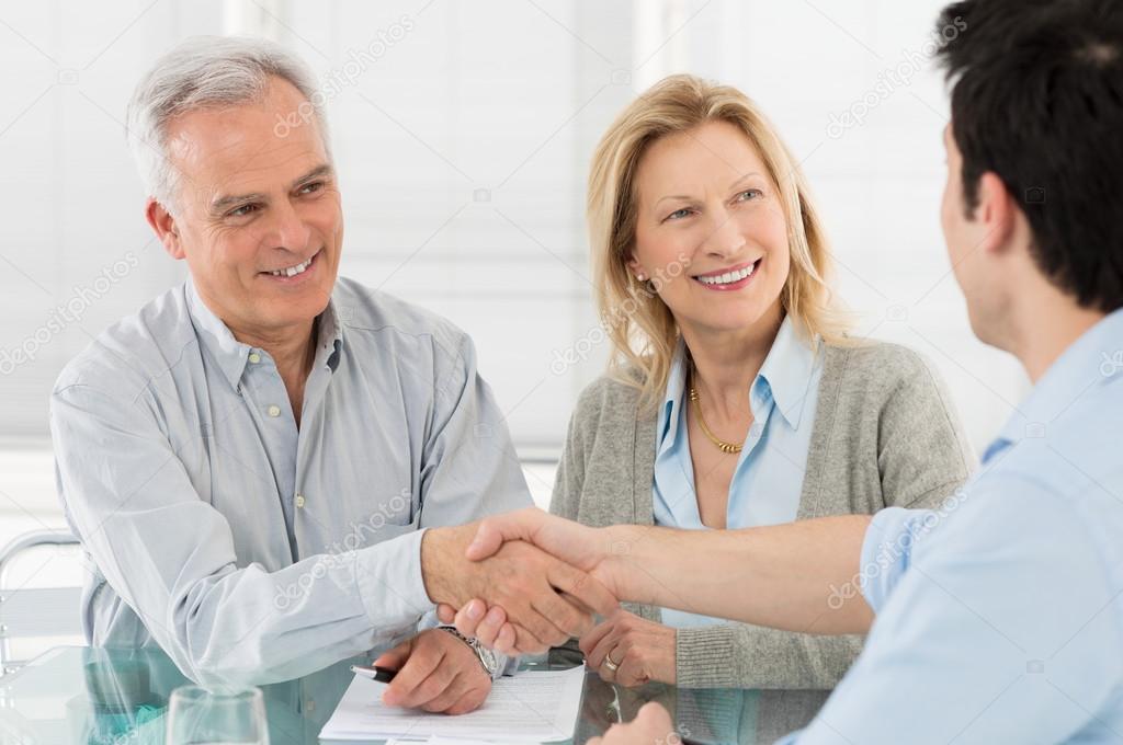 Senior Happy Couple With Financial Advisor