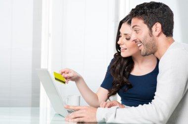 Surpised couple internet shopping