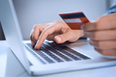 Close Up Of A Man Shopping Online Using Laptop With Credit Card stock vector
