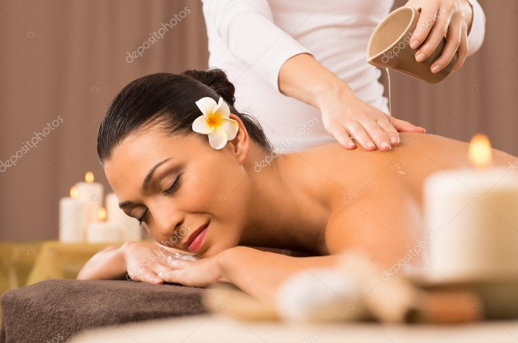 Woman Having A Back Oil Massage