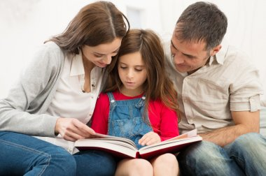Parents Helping Daughter In Studies
