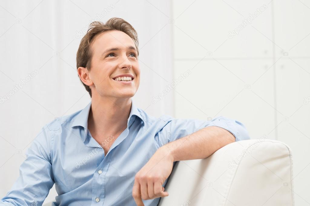 Young Man Daydreaming Stock Photo