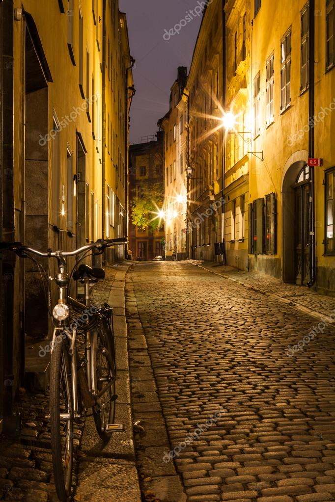 Фотообои Empty street in Stockholm Old town at night.