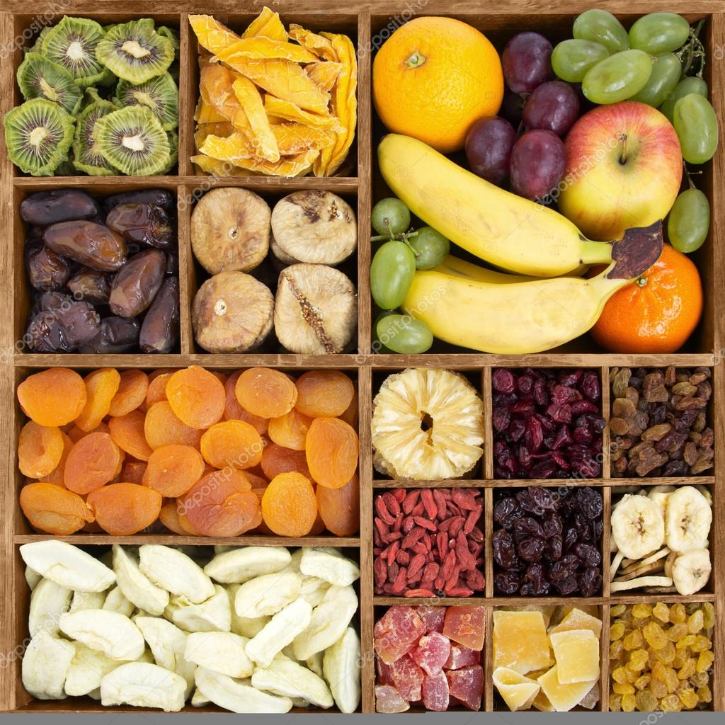Dry fruits with fresh fruits in a wood box