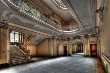 The entrance hall of an abandoned house