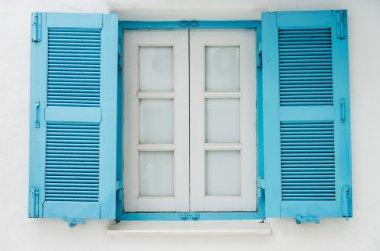 Blue wooden window on white wall6
