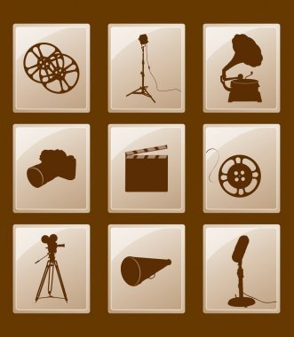 Set of icons with retro silhouettes; gramophone, reflector, film