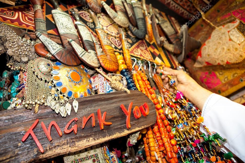 Thank you written on board in souvenir shop on market (suk) in