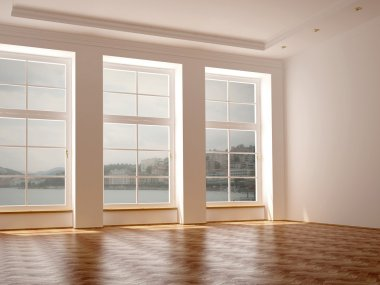 A spacious room with three large windows