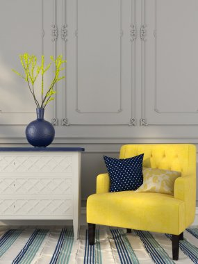 Yellow chair near the white chest of drawers