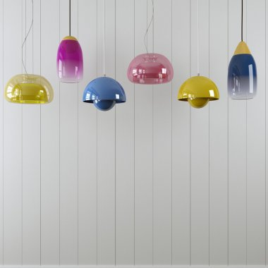 Varicolored hanging lamps against a white wall