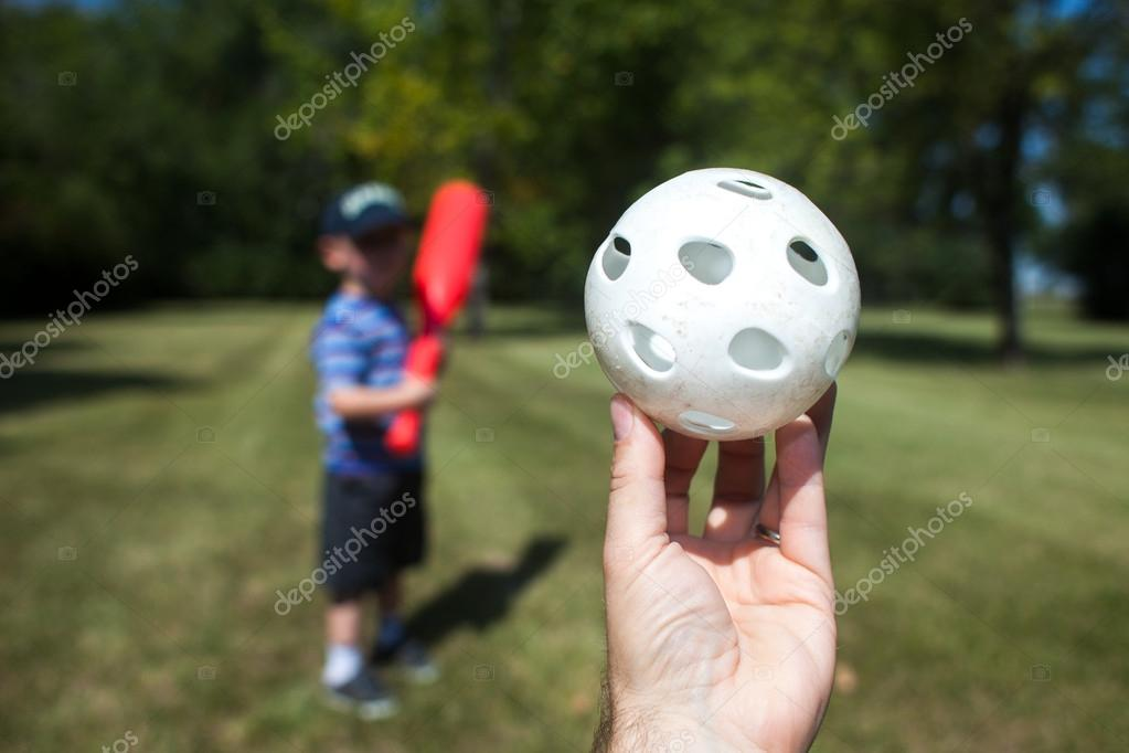 Youth Waits for Wiffle Ball Pitch