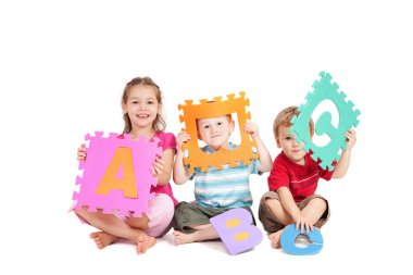 Three kids having fun learning with alphabet ABC letters. Isolated on white. stock vector