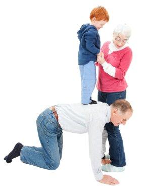 Grandparents having fun with boy grandchild