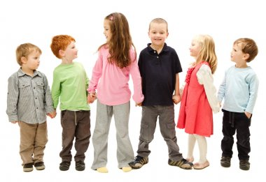 Group of happy kids holding hands