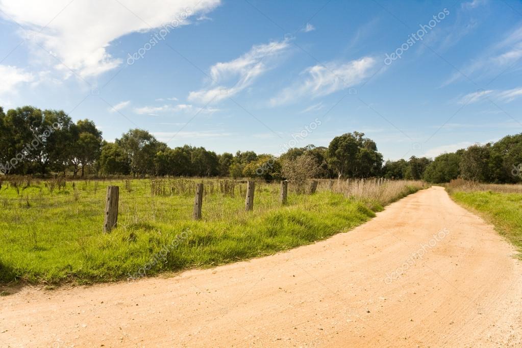 Dirt road under sunny blue sky
