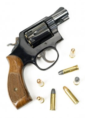 Wood Handled Revolver 38 Caliber Pistol Loaded Laying With Bulli