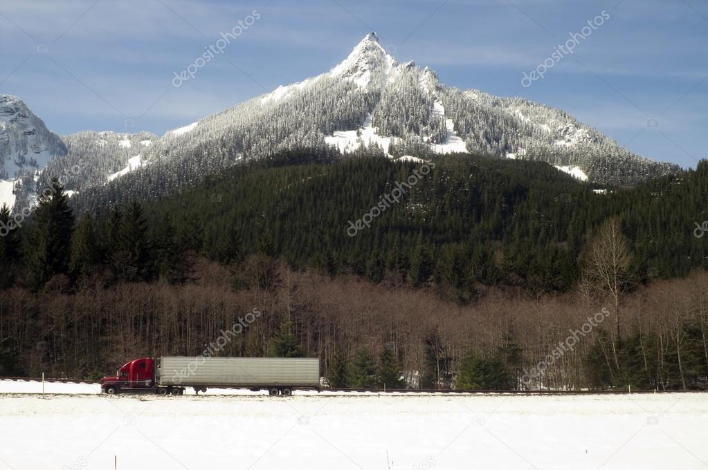 Truck Transports Goods Over Road Highway Through North Cascades Washington